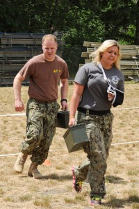 150612-N-OO032-220 SILVERDALE, Wash. (June 12, 2015) -- Master-at-Arms 3rd Class Christopher Obourn, a Washington, Illinois native assigned to Marine Corps Security Force Battalion (MCSFBn) - Bangor, helps his wife, Caylyn Obourn, with the ammo can run portion of the Marine Corps Combat Fitness Test as a part of 's Jayne Wayne Day at Naval Base Kitsap - Bangor. Jayne Wayne Day is an annual Marine Corps tradition engaging military spouses in various aspects of their Sailors' and Marines' lives on duty. (U.S. Navy photo by Mass Communication Specialist 2nd Class Cory Asato/Released)