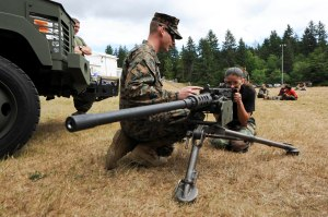 150612-N-OO032-288 SILVERDALE, Wash. (June 12, 2015) -- Sgt. Michael Scott, from Germany and assigned to Marine Corps Security Battalion (MCSFBn) - Bangor, explains how to properly use the sight of a Browning M2 50 caliber machine gun as a part of MCSFBn's Jayne Wayne Day at Naval Base Kitsap - Bangor. Jayne Wayne Day is an annual Marine Corps tradition engaging military spouses in various aspects of their Sailors' and Marines' lives on duty. (U.S. Navy photo by Mass Communication Specialist 2nd Class Cory Asato/Released)