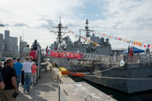 140801-N-QY316-015 SEATTLE (Aug. 1, 2014) a tour group boards the Arleigh Burke-class guided-missile destroyer USS Howard (DDG 83) during Seattle Seafair Fleet Week 2014. Seafair is an annual celebration that allows the local community to meet and interact with maritime forces from the U.S. and Canada. (U.S. Navy photo by Mass Communication Specialist 3rd Class William Blees/Released)