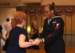 EVERETT, Wash. (Nov. 11, 2016) Petty Officer 1st Class Kishan Gumbs, assigned to Naval Station Everett (NSE), dances with a patron during the 11th Annual Veterans Day United Service Organizations dance at the Carl Gibson Senior Center in Everett. Each year Sailors from NSE are invited to volunteer and attend the Veterans Day event. (U.S. Navy photo by Petty Officer 2nd Class Alex Van'tLeven/Released)