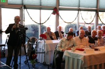 OAK HARBOR, Wash. (Dec. 7, 2016) Howard Gulley, commanding officer, Association of Naval Aviation, Whidbey Island Squadron, gives a presentation on the events of World War II during a luncheon at Naval Air Station Whidbey Island's Officers Club. The event honored WWII veterans on the 75th anniversary of the Dec. 7, 1941 Japanese attack on Pearl Harbor. (U.S. Navy photo by Petty Officer 2nd Class John Hetherington/Released)