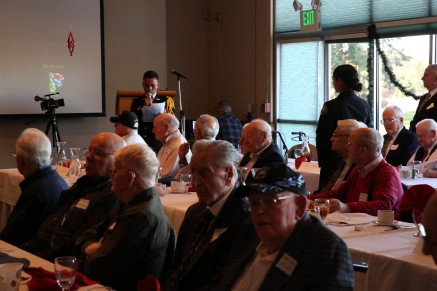 OAK HARBOR, Wash. (Dec. 7, 2016) Johnathan Francisco, Oak Harbor High School Navy Junior ROTC, reads biographies of Word War II veterans in attendance during a luncheon at Naval Air Station Whidbey Island's Officers Club. The event honored WWII veterans on the 75th anniversary of the Dec. 7, 1941 Japanese attack on Pearl Harbor. (U.S. Navy photo by Petty Officer 2nd Class John Hetherington/Released)