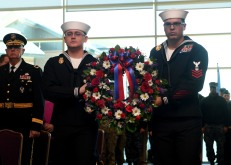 EVERETT, Wash. (Dec. 7, 2016) Seaman Steven Orick and Petty Officer 1st Class Steven LeGuillow participate in a wreath laying during the Pearl Harbor 75th Commemoration and World War II Remembrance Ceremony in Naval Station Everett Grand Vista Ballroom. Service members, veterans and civilians came together at NSE to honor the men and women who fought and died in Pearl Harbor and World War II. (U.S. Navy photo by Petty Officer 3rd Class Joseph Montemarano/Released)