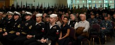 EVERETT, Wash. (Dec. 7, 2016) Civilians, veterans and service members assigned to Naval Station Everett (NSE) watch a Pearl Harbor video during the Pearl Harbor 75th Commemoration and World War II Remembrance Ceremony in NSE Grand Vista Ballroom`. Service members, veterans and civilians came together at NSE to honor the men and women who fought and died in Pearl Harbor and World War II. (U.S. Navy photo by Petty Officer 3rd Class Joseph Montemarano/Released)