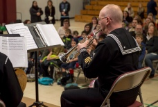 161214-N-ZP059-033 SILVERDALE Wash., (Dec. 14, 2016) Petty Officer 1st Class Chris Hodges, a member of Navy Band Northwest's Brass Quintet, plays his trumpet during a holiday concert at Central Kitsap Middle School. This was the first time that the Brass Quintet has played at Central Kitsap Middle School. (U.S. Navy photo by Petty Officer 2nd Class Jacob G. Sisco/Released)