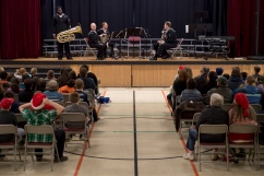 161214-N-ZP059-060 SILVERDALE Wash., (Dec. 14, 2016) Petty Officer 3rd Class Patrick Melvin, a member of Navy Band Northwest's Brass Quintet, talks about his tuba during a holiday concert at Central Kitsap Middle School for parents, students and staff. This was the first time that the Brass Quintet has played at Central Kitsap Middle School. (U.S. Navy photo by Petty Officer 2nd Class Jacob G. Sisco/Released)