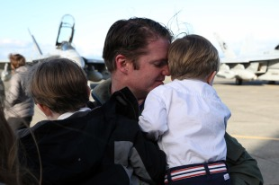161230-N-DC740-043 OAK HARBOR, Wash. (Dec. 30, 2016) Cmdr. Brendan Stickles, commanding officer, Electronic Attack Squadron 130, holds his sons after returning home from deployment at Naval Air Station Whidbey Island. Electronic Attack Squadron 130 conducted electronic warfare operations in the 5th Fleet area of responsibility while embarked on USS Dwight D. Eisenhower (CVN 69). (U.S. Navy photo by Mass Communication Specialist 2nd Class John Hetherington/Released)