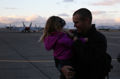 161230-N-DC740-098 OAK HARBOR, Wash. (Dec. 30, 2016) Aviation Electronics Technician 2nd Class David Edwards, Electronic Attack Squadron 130, holds his daughter after returning home from deployment at Naval Air Station Whidbey Island. Electronic Attack Squadron 130 conducted electronic warfare operations in the 5th Fleet area of responsibility while embarked on USS Dwight D. Eisenhower (CVN 69). (U.S. Navy photo by Mass Communication Specialist 2nd Class John Hetherington/Released)