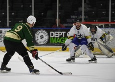 170204-N-WX604-519 EVERETT, Wash. (Feb. 4, 2017) – Marine Sgt. Spencer Alvarez, an Anchorage, Alaska, native assigned to Naval Station Everett, participates in the 2nd Annual Pacific Northwest Army-Navy ice hockey game at the Xfinity Arena. The Everett Silvertips, a minor league hockey team, hosted the Morale, Welfare, and Recreation sponsored event. (U.S. Navy photo by Mass Communication Specialist 3rd Class Joseph Montemarano/Released)