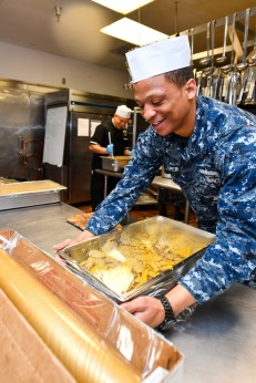 170502-N-EC099-090 SILVERDALE, Wash. (May 2, 2017) Culinary Specialist 2nd Class Lawrence Jasper, assigned to Naval Base Kitsap's Trident Inn Galley, wraps potatoes in plastic-wrap in preparation of lunch. Culinary Specialists operate and manage dining facilities and living quarters for Sailors and Marines in the U.S. Navy. (U.S. Navy photo by Mass Communication Specialist 3rd Class Charles D. Gaddis IV/Released)