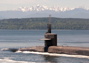 PUGET SOUND, Wash. (May 22, 2017) The Ohio-class ballistic-missile submarine USS Louisiana (SSBN 743) transits the Hood Canal as it returns to its homeport following a strategic deterrent patrol. Louisiana is one of eight ballistic-missile submarines stationed at Naval Base Kitsap-Bangor providing the most survivable leg of the strategic deterrence triad for the United States. (U.S. Navy photo by Lt. Cmdr. Michael Smith/Released)
