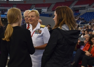 170610-N- HM829-008 PORTLAND, Ore. (June 10, 2017) Vice Adm. Nora Tyson, commander of U.S. 3rd Fleet, greets Portland High School chorus singers before the Grand Floral Parade held at Veterans Memorial Coliseum during Portland Rose Festival Fleet Week 2017. The festival and Portland Fleet Week are a celebration of the sea services with Sailors, Marines, and Coast Guard members from the U.S. and Canada making the city a port of call. (U.S. Navy photo by Mass Communication Specialist 2nd Class K. Cecelia Engrums/Released)