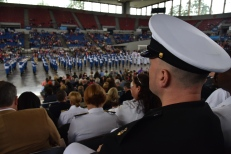 170610-N- HM829-016 PORTLAND, Ore. (June 10, 2017) Service members watch the Grand Floral Parade from Veterans Memorial Coliseum during Portland Rose Festival Fleet Week 2017. The festival and Portland Fleet Week are a celebration of the sea services with Sailors, Marines, and Coast Guard members from the U.S. and Canada making the city a port of call. (U.S. Navy photo by Mass Communication Specialist 2nd Class K. Cecelia Engrums/Released)