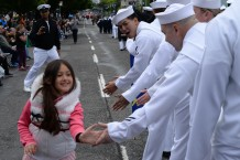 PORTLAND, Ore. (June 10, 2017) – A young girl high-fives Sailors assigned to the submarine tender USS Frank Cable (AS 40) at the Grand Floral Parade during Rose Festival Fleet Week in Portland, Ore., June 10. The festival and Portland Fleet Week are a celebration of the sea services with Sailors, Marines and Coast Guard members from the U.S. and Canada making the city a port of call. (U.S. Navy photo by Mass Communication Specialist 1st Class Eva-Marie Ramsaran/Released)