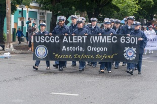 170610-N-ZP059-107 PORTLAND Ore., (June 10, 2017) – U.S Coast Guard members assigned to the medium endurance cutter Alert (WMEC-630) walk along the Rose Festival Parade route in Portland, Ore., during Portland Rose Festival Fleet Week. The festival and Portland Fleet Week are a celebration of the sea services with Sailors, Marines, and Coast Guard members from the U.S. and Canada making the city a port of call. (U.S. Navy photo by Mass Communication Specialist 2nd Class Jacob G. Sisco/Released)