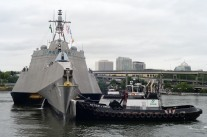 PORTLAND, Ore. (June 12, 2017) – Tugboats maneuver the Independence-class littoral combat ship USS Jackson (LCS 6) to get underway after participating in Portland Rose Festival Fleet Week in Portland, Ore., June 12. The festival and Portland Fleet Week are a celebration of the sea services with Sailors, Marines and Coast Guard members from the U.S. and Canada making the city a port of call. (U.S. Navy photo by Mass Communication Specialist 1st Class Eva-Marie Ramsaran/Released)