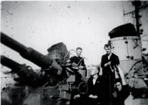Gunners Mate Schramm firing a gun