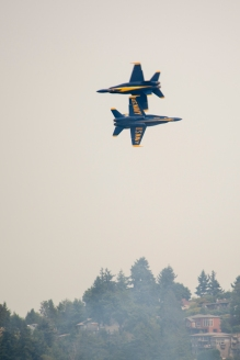 170805-N-ZP059-335 SEATTLE (Aug. 5, 2017) – Two pilots of the U.S. Navy Flight Demonstration Squadron, the Blue Angels, do a fly-by over Lake Washington while performing at an airshow during Seattle's 68th annual Seafair Fleet Week. Seafair Fleet Week is an annual celebration of the sea services wherein Sailors, Marines and Coast Guard members from visiting U.S. Navy and Coast Guard ships and ships from Canada make the city a port of call. (U.S. Navy photo by Mass Communication Specialist 2nd Class Jacob G. Sisco/Released)