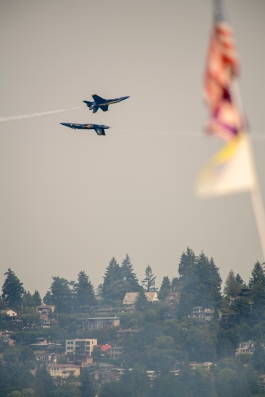 170805-N-ZP059-356 SEATTLE (Aug. 5, 2017) – Two pilots of the U.S. Navy Flight Demonstration Squadron, the Blue Angels, do a fly-by over Lake Washington while performing at an airshow during Seattle's 68th annual Seafair Fleet Week. Seafair Fleet Week is an annual celebration of the sea services wherein Sailors, Marines and Coast Guard members from visiting U.S. Navy and Coast Guard ships and ships from Canada make the city a port of call. (U.S. Navy photo by Mass Communication Specialist 2nd Class Jacob G. Sisco/Released)