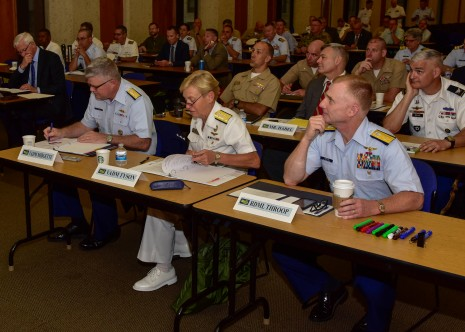 170803-N-MT581-310 SEATTLE (Aug. 03, 2017) U.S. Navy Vice Adm. Nora Tyson, center, commander, U.S. 3rd Fleet, observes a presentation with U.S. Coast Guard Vice Adm. Fred M. Midgette, left, commander, Pacific Area and Coast Guard Defense Force West, and U.S. Coast Guard Rear Adm. David G. Throop, commander, District 13, during a Defense Support of Civilian Authorities (DSCA) senior leadership seminar held at the Jackson Federal Building during Seattle Seafair Fleet Week. Seafair Fleet Week is an annual celebration of the sea services wherein Sailors, Marines and Coast Guard members from visiting U.S. Navy and Coast Guard ships and ships from Canada make the city a port of call. (U.S. Navy photo by Mass Communication Specialist 2nd Class Curtis D. Spencer/Unreleased.)