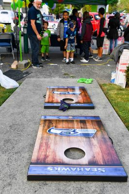 "170916-N-EC099-025 KEYPORT, Wash. (Sept. 16, 2017) - Children participate in a ""Seahawk Toss"" during Keyport's annual 2017 Keyport Fest celebration. Keyport Fest, hosted by the Keyport Improvement Club, is open to all and increases the morale and connection between Keyport and its surrounding communities. (U.S. Navy photo by Mass Communication Specialist 3rd Class Charles D. Gaddis IV/Released)"