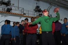 "170917-N-ZU663-033 PACIFIC OCEAN (Sept. 17, 2017) Aviation Boatswain's Mate (Equipment) 3rd Class Joshua Baud, from Elizabeth, Colorado, throws a football while wearing goggles to simulate the effects of alcohol during a ""Tackle the DUI"" tailgating event in the hangar bay aboard USS John C. Stennis (CVN 74). John C. Stennis is underway training for future operations after completing flight deck certification and carrier qualifications. (U.S. Navy photo by Mass Communication Specialist 2nd Class Susan C. Damman/Released)"