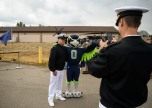 170920-N-VH385-063 JOINT BASE LEWIS-MCCHORD, Wash. (Sept. 19, 2017) Master Chief Fire Controlman Christopher Stonger, assigned to Afloat Training Group Pacific Northwest, poses for a photo with Blitz, the Seattle Seahawks mascot, during the 6th annual USAA Change of Command ceremony at Joint Base Lewis-McChord. This year the Seattle Seahawks and USAA presented the Army's 1st Special Forces Group with the 12th Man Flag, following a season of Navy Region Northwest carrying to flag. (U.S. Navy photo by Mass Communication Specialist 2nd Class Wyatt L. Anthony)