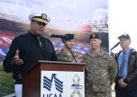 170920-N-VH385-117 JOINT BASE LEWIS-MCCHORD, Wash. (Sept. 19, 2017) Rear Adm. Gary Mayes, commander Navy Region Northwest, speaks during the 6th annual USAA Change of Command ceremony at Joint Base Lewis-McChord. This year the Seattle Seahawks and USAA presented the Army's 1st Special Forces Group with the 12th Man Flag, following a season of Navy Region Northwest carrying to flag. (U.S. Navy photo by Mass Communication Specialist 2nd Class Wyatt L. Anthony)