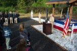 170921-N-EH218-051 SILVERDALE, Wash. (Sept. 21, 2017) Capt. Alan Schrader, Commanding Officer, Naval Base Kitsap (NBK), delivers remarks during a Bells Across America remembrance event held at the 9/11 Memorial Park on NBK - Bangor. NBK and the Navy Gold Star Program hosted the ceremony to honor fallen service members and gold star families. (U.S. Navy photo by Mass Communication Specialist 2nd Class Ryan J. Batchelder/Released)