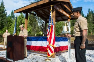 170921-N-EH218-066 SILVERDALE, Wash. (Sept. 21, 2017) Master Chief Petty Officer James Willis, Command Master Chief, Naval Base Kitsap (NBK), reads the names of fallen service members during a Bells Across America remembrance event held at the 9/11 Memorial Park on NBK - Bangor. NBK and the Navy Gold Star Program hosted the ceremony to honor fallen service members and gold star families. (U.S. Navy photo by Mass Communication Specialist 2nd Class Ryan J. Batchelder/Released)
