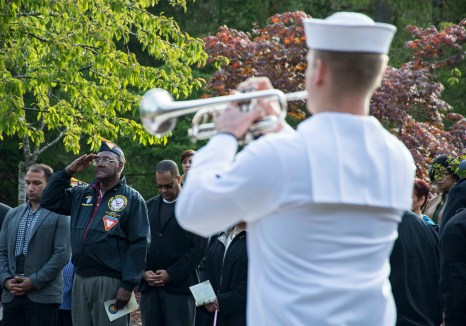 170921-N-EH218-076 SILVERDALE, Wash. (Sept. 21, 2017) Retired Senior Chief Navy Diver Eugene Garcia, from Olalla, Wash., salutes as Taps is played during a Bells Across America remembrance event held at the 9/11 Memorial Park on NBK - Bangor. NBK and the Navy Gold Star Program hosted the ceremony to honor fallen service members and gold star families. (U.S. Navy photo by Mass Communication Specialist 2nd Class Ryan J. Batchelder/Released)