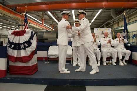 KEYPORT, Wash. (Sept. 26, 2017) Capt. Robert Gaucher, from Pittsfield, Massachusetts, right, turns over command to Capt. Stephen Mack, from Silver Spring, Maryland, during a change of command ceremony, held at Barb Hall, for Submarine Development Squadron (DEVRON) 5. DEVRON 5 is responsible for multiple submarine warfare areas to include submarine rescue operations and the activities of its three Seawolf-class submarines. (U.S. Navy photo by Mass Communication Specialist 1st Class Amanda R. Gray/Released)
