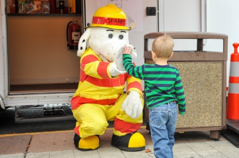 Sparky the Fire Dog high fives