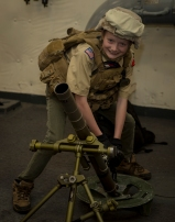 180731-M-OI329-1071 SEATTLE (Aug 1, 2018) A Boy Scout of America poses for a picture aboard amphibious transport dock ship USS Somerset (LPD 25) during Seafair Fleet Week. Seafair Fleet Week is an annual celebration of the sea services wherein Sailors, Marines and Coast Guard members from visiting U.S. Navy and Coast Guard ships and ships from Canada make the city a port of call. (U.S. Marine Corps photo by Cpl. Joseph Prado)