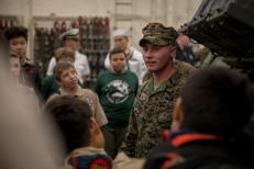 180731-M-OI329-1166 SEATTLE (Aug 1, 2018) A U.S Marine instructs Boy Scouts of America about Marine Equipment aboard amphibious transport dock ship USS Somerset (LPD 25) during Seafair Fleet Week. Seafair Fleet Week is an annual celebration of the sea services wherein Sailors, Marines and Coast Guard members from visiting U.S. Navy and Coast Guard ships and ships from Canada make the city a port of call. (U.S. Marine Corps photo by Cpl. Joseph Prado)