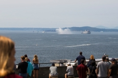 180731-M-ST406-1005 SEATTLE (July 31, 2018) Civilians watch the arrival of the USS Somerset (LPD 25) during the 69th annual Seafair Fleet Week. Seafair Fleet Week is an annual celebration of the sea services wherein Sailors, Marines and Coast Guard members from visiting U.S. Navy and Coast Guard ships and ships from Canada make the city a port of call. (U.S. Marine Corps photo by Ana S. Madrigal)