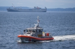 180731-M-ST406-1020 SEATTLE (July 31, 2018) A boat crew from the U.S. Coast Guard provides security at the parade of ships during the 69th annual Seafair Fleet Week. Seafair Fleet Week is an annual celebration of the sea services wherein Sailors, Marines and Coast Guard members from visiting U.S. Navy and Coast Guard ships and ships from Canada make the city a port of call. (U.S. Marine Corps photo by Ana S. Madrigal)