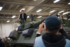 180731-N-DA737-0085 PUGET SOUND, Wash. (July 31, 2018) Hee Joo Park, a ship rider, poses for a picture atop an LAV-25 Light Armored Vehicle static display onboard the amphibious transport dock ship USS Somerset (LPD 25). Somerset is arriving in Seattle for Seafair Fleet Week, an annual celebration of the sea services wherein Sailors, Marines and Coast Guard members from visiting U.S. Navy and Coast Guard ships and ships from Canada make the city a port of call. (U.S. Navy photo by Mass Communication Specialist 2nd Class Jonathan Jiang/Released)