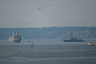 180731-N-SH284-0046 SEATTLE (July 31, 2018) A Coast Guard HC-130 long range surveillance aircraft performs a flyover while amphibious transport dock ship USS Somerset (LPD 25), left, and guided-missile destroyer USS Momsen (DDG 92) participate in a parade of ships in Elliott Bay during the 69th annual Seafair Fleet Week. Seafair Fleet Week is an annual celebration of the sea services wherein Sailors, Marines and Coast Guard members from visiting U.S. Navy and Coast Guard ships and ships from Canada make the city a port of call. (U.S. Navy photo by Mass Communication Specialist 2nd Class Vaughan Dill/Released)