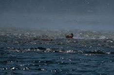 180731-N-SH284-0063 SEATTLE (July 31, 2018) A U.S. Coast Guard rescue diver swims towards a dummy while performing a mock rescue during a search and rescue demonstration over Elliott Bay as part of the 69th annual Seafair Fleet Week. Seafair Fleet Week is an annual celebration of the sea services wherein Sailors, Marines and Coast Guard members from visiting U.S. Navy and Coast Guard ships and ships from Canada make the city a port of call. (U.S. Navy photo by Mass Communication Specialist 2nd Class Vaughan Dill/Released)