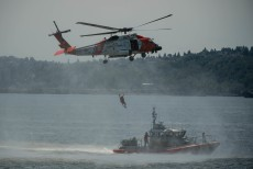 180731-N-SH284-0086 SEATTLE (July 31, 2018) A U.S. Coast Guard MH-60T Jayhawk Helicopter recovers a diver while performing a mock rescue during a search and rescue demonstration over Elliott Bay as part of the 69th annual Seafair Fleet Week. Seafair Fleet Week is an annual celebration of the sea services wherein Sailors, Marines and Coast Guard members from visiting U.S. Navy and Coast Guard ships and ships from Canada make the city a port of call. (U.S. Navy photo by Mass Communication Specialist 2nd Class Vaughan Dill/Released)
