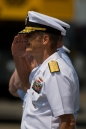 180731-N-SH284-0190 SEATTLE (July 31, 2018) Rear Adm. Scott Gray, commander, Navy Region Northwest, performs a hand salute at a pass in revue while participating in a parade of ships in Elliott Bay during the 69th annual Seafair Fleet Week. Seafair Fleet Week is an annual celebration of the sea services wherein Sailors, Marines and Coast Guard members from visiting U.S. Navy and Coast Guard ships and ships from Canada make the city a port of call. (U.S. Navy photo by Mass Communication Specialist 2nd Class Vaughan Dill/Released)