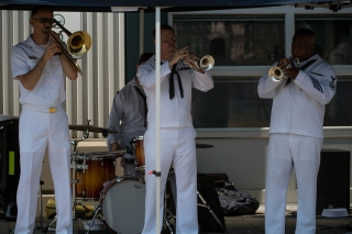 180731-N-SH284-0205 SEATTLE (July 31, 2018) Navy Band Northwest performs at pier 66 as part of the 69th annual Seafair Fleet Week. Seafair Fleet Week is an annual celebration of the sea services wherein Sailors, Marines and Coast Guard members from visiting U.S. Navy and Coast Guard ships and ships from Canada make the city a port of call. (U.S. Navy photo by Mass Communication Specialist 2nd Class Vaughan Dill/Released)
