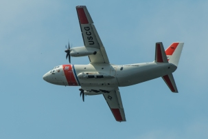 180731-N-SH284-0229 SEATTLE (July 31, 2018) A Coast Guard HC-130 long range surveillance aircraft performs a flyover at a parade of ships in Elliott Bay during the 69th annual Seafair Fleet Week. Seafair Fleet Week is an annual celebration of the sea services wherein Sailors, Marines and Coast Guard members from visiting U.S. Navy and Coast Guard ships and ships from Canada make the city a port of call. (U.S. Navy photo by Mass Communication Specialist 2nd Class Vaughan Dill/Released)