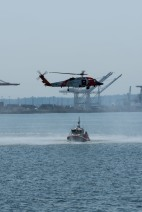180731-N-SH284-0273 SEATTLE (July 31, 2018) A U.S. Coast Guard MH-60T Jayhawk Helicopter performs a mock rescue during a search and rescue demonstration over Elliott Bay as part of the 69th annual Seafair Fleet Week. Seafair Fleet Week is an annual celebration of the sea services wherein Sailors, Marines and Coast Guard members from visiting U.S. Navy and Coast Guard ships and ships from Canada make the city a port of call. (U.S. Navy photo by Mass Communication Specialist 2nd Class Vaughan Dill/Released)