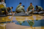 180801-M-OI329-1028 SEATTLE (Aug 1, 2018) U.S Marines and Sailors clean gym equipment at the Young Men's Christian Association during Seafair Fleet Week. Seafair Fleet Week is an annual celebration of the sea services wherein Sailors, Marines and Coast Guard members from visiting U.S. Navy and Coast Guard ships and ships from Canada make the city a port of call. (U.S. Marine Corps photo by Cpl. Joseph Prado)