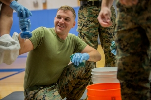 180801-M-OI329-1033 SEATTLE (Aug 1, 2018) U.S Marines clean gym equipment at the Young Men's Christian Association during Seafair Fleet Week. Seafair Fleet Week is an annual celebration of the sea services wherein Sailors, Marines and Coast Guard members from visiting U.S. Navy and Coast Guard ships and ships from Canada make the city a port of call. (U.S. Marine Corps photo by Cpl. Joseph Prado)