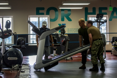 180801-M-OI329-1068 SEATTLE (Aug 1, 2018) U.S Marines and Sailors assist in moving equipment at the Young Men's Christian Association during Seafair Fleet Week. Seafair Fleet Week is an annual celebration of the sea services wherein Sailors, Marines and Coast Guard members from visiting U.S. Navy and Coast Guard ships and ships from Canada make the city a port of call. (U.S. Marine Corps photo by Cpl. Joseph Prado)