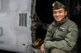 180801-M-ST406-1023 SEATTLE ( August 1, 2018) U.S. Marine Corps Cpl. Jackson Chang, a crew chief with Marine Medium Tiltrotor Squadron 364, poses for a portrait during the 69th annual Seafair Fleet Week. Seafair Fleet Week is an annual celebration of the sea services wherein Sailors, Marines and Coast Guard members from visiting U.S. Navy and Coast Guard ships and ships from Canada make the city a port of call. (U.S. Marine Corps photo by Lance Cpl. Ana S. Madrigal)