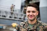 180801-M-ST406-1026 SEATTLE ( August 1, 2018) U.S. Marine Corps Cpl. Benjamin Googe, a rifleman with 2nd Battalion, 7th Marine Regiment, 1st Marine Division, poses for a protrait during the 69th annual Seafair Fleet Week. Seafair Fleet Week is an annual celebration of the sea services wherein Sailors, Marines and Coast Guard members from visiting U.S. Navy and Coast Guard ships and ships from Canada make the city a port of call. (U.S. Marine Corps photo by Lance Cpl. Ana S. Madrigal)